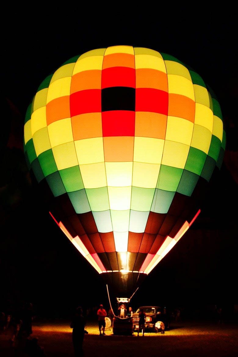 Spitfire balloon glowing at the Freedom Balloon Fest in North Carolina